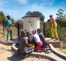 AquaAid sponsored elephant pump with children using it
