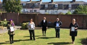 Handing over of certificates in Woodhouse Gardens