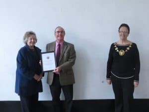Derek Andrews receiving the Certificate of Appreciation